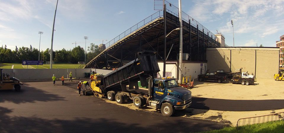 Paving contractor at work at Kitchener Stadium